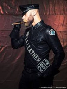 Eric Paul Leau - striking what appears to be a leather clad Nazi BDSM pose