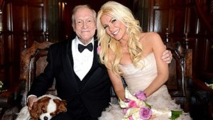 Hugh Hefner - America's DIRTY OLD MAN NEXT DOOR and his wife who looks like she could be his daughter (or grand daughter).