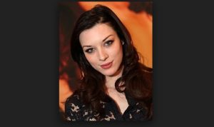 stoya leaves trenchcoat x with not much more than a Goodbye